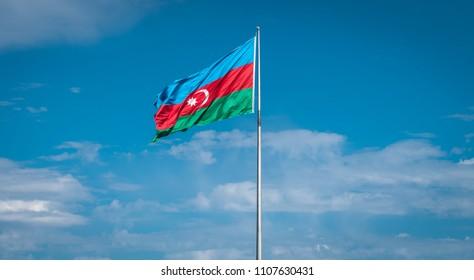 Baku, Azerbaijan - April 2018: Azerbaijan Flag against blue sky