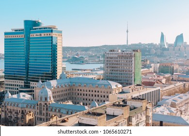 Baku, Azerbaijan - April, 2018: Spectacular aerial view of Caspian Sea, skyscrapers, Hilton Hotel, Flame Towers, BEGOC Plaza from top of the building