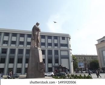 "Baku / Azerbaijan - August, 2019: Poet Jafar Jabbarli Statue. The monument of the novelist Jafar Jabbarli. It is located near the Azerbaijan Main Railway Station and ""28 May"" Subway station in Baku."
