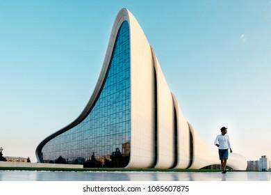 Baku, Azerbaijan - August 24, 2017: Young people walks on the teritory of Heydar Aliev Center, Baku, Azerbaijan