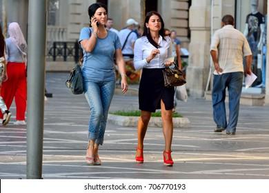 BAKU, AZERBAIJAN - AUGUST 28, 2017. People walking on the Fountains Square in Baku.