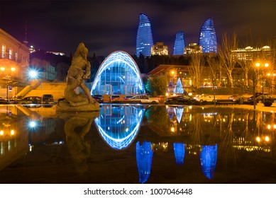 BAKU, AZERBAIJAN - DECEMBER 29, 2017: The Bakhram-Gur memorial fountain and Flame towers in a night landscape