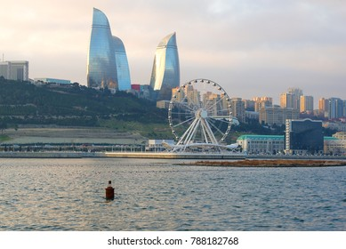 BAKU, AZERBAIJAN - DECEMBER 29, 2017: View of the Ferris wheel and the Flame Towers on a December cloudy day