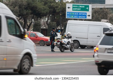 BAKU, AZERBAIJAN - FEBRUARY 2, 2019: traffic policeman on the city streets