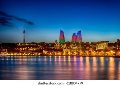 Baku, Azerbaijan - February 23, 2017: Night view of Baku with the Flame Towers skyscrapers, television tower and the seaside of the Caspian sea.