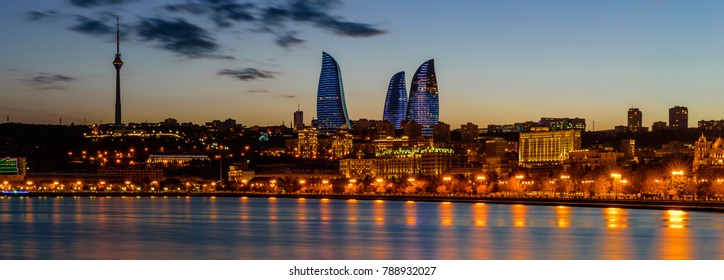 Baku, Azerbaijan - February 23, 2017: Night view of Baku with the Flame Towers skyscrapers, television tower and the seaside of the Caspian sea
