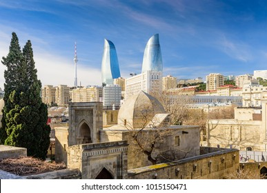 Baku, Azerbaijan - FEBRUARY 24, 2017: Flame towers in the cityscape. View from old town. Panoramic view of Baku - the capital of Azerbaijan located by the Caspian See shore.