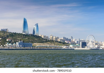 Baku, Azerbaijan - February 24, 2017: the waterfront of the Caspian sea in the center of Baku. View of the Baku towers. Baku Flame Towers are popular modern architectural and tourist attraction in Bak
