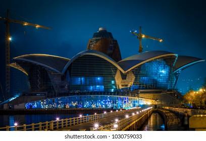 Baku, Azerbaijan - January 01, 2018: Night view on the Caspian Waterfront Mall Baku building construction. Night city view Caspian Waterfront Mall Baku with building construction