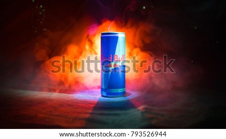 BAKU, AZERBAIJAN - January 13, 2018: Red Bull classic 250 ml can on dark toned foggy background. Red Bull is an energy drink sold by Austrian company Red Bull GmbH