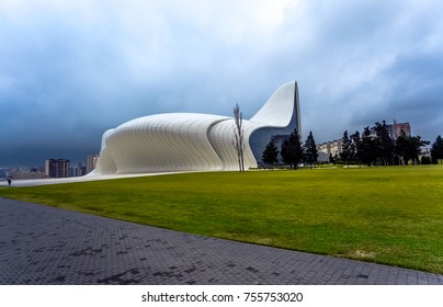 BAKU, AZERBAIJAN - JANUARY 16, 2017: Heydar Aliyev Center. Front view on building in a futuristic style and green grass and trees.
