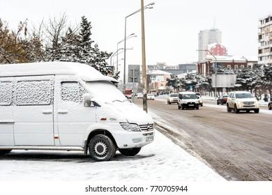 Baku, Azerbaijan, January 25, 2017. Snowfall in the city, cars on street