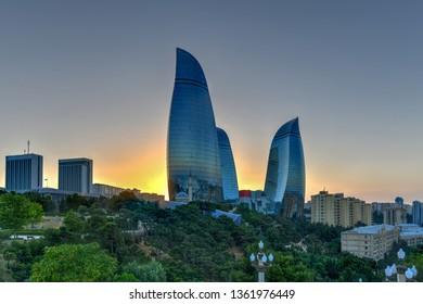 Baku, Azerbaijan - July 14, 2018: The Flame Towers in Baku, Azerbaijan. A view of the city skyline on a dramatical sunset.