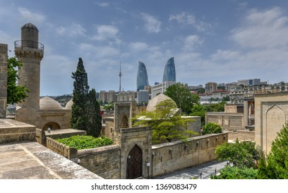 Baku, Azerbaijan - July 15, 2018: The Palace of the Shirvanshahs is a 15th-century palace built by the Shirvanshahs, located in the Old City of Baku, Azerbaijan. Flame towers in the background.
