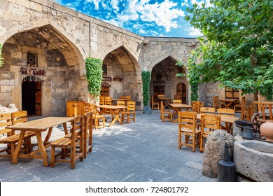 Baku, Azerbaijan - July 16, 2015: caravanserai restaurant and shopping center where venders have been selling carpets and pottery since the ancient times located in old town Baku