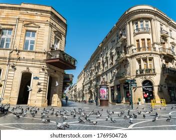 Baku, Azerbaijan – July 4, 2020. View of pedestrian Nizami street in downtown Baku, with pigeons. View without people in summer.