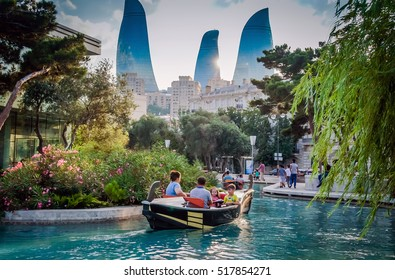 BAKU, AZERBAIJAN - JULY 8, 2016: View of Flame Towers. Flame Towers - the highest building in Azerbaijan located in Baku. Three Flame Towers Baku. View of Baku Flame towers sunset background wallpaper