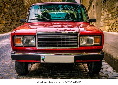 BAKU, AZERBAIJAN - JULY 8, 2016: View from front at russian classic car Lada Auto. Red soviet motor auto in the city street. Car front view from side. Car front exterior. Car front window