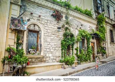 BAKU, AZERBAIJAN - JULY 8, 2016: Decorative home design from a fairy tale. Mansion exterior luxury property. Mansion Luxury design background. Mansion house Luxury apartment. Luxury detail flat