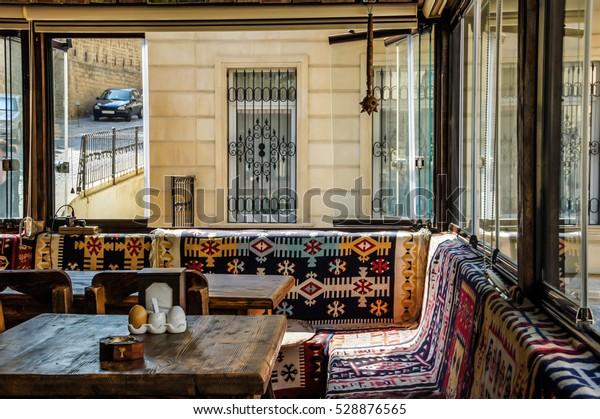 BAKU, AZERBAIJAN - JULY 9, 2016: Cafe interior Tandir Baku. Beautiful carpet style interior.  Restaurant interior design.  Vintage Cafe Interior Exclusive design ideas. Middle East restaurant design