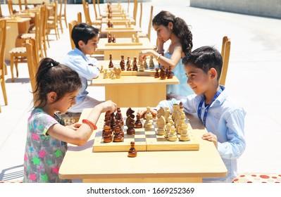 BAKU, AZERBAIJAN - JUNE 1 2019 : Kids festival . In park of Heydar Aliyev Center. Children play chess
