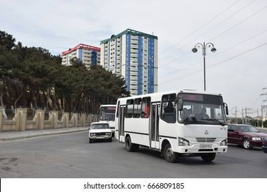 Baku, Azerbaijan - May 09, 2017. Cars and white bus in traffic in the northeast uptown