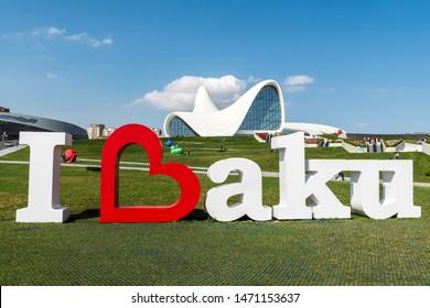 Baku, Azerbaijan - May 14, 2019. I Love Baku sign with Heydar Aliyev Complex building in the background, in Baku.
