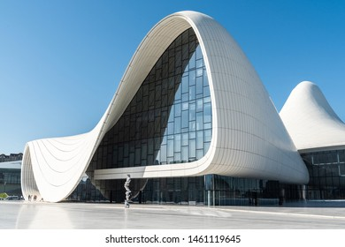 Baku, Azerbaijan - May 2, 2019. Elements of exterior design of Heydar Aliyev Complex building in Baku, with people. Designed by Iraqi-British architect Zaha Hadid and opened in 2012.