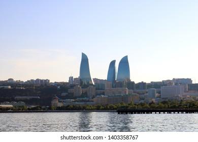 Baku, Azerbaijan - May 20, 2019: View  from The Caspian Sea to Flame Towers. Baku Flame Towers is the tallest skyscraper in Baku, Azerbaijan