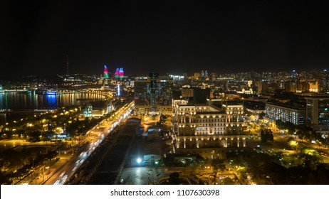Baku, Azerbaijan - May 2018: Baku night cityscape with flaming towers and downtown Baku
