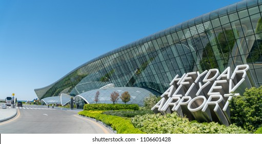 Baku, Azerbaijan - May 2018: The sign of Heydar Aliyev Airport next to its main Terminal