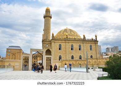 Baku, Azerbaijan, September, 10, 2019. People walking near Tezepir mosque  in Baku in cloudy day
