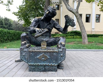 Baku, Azerbaijan, September, 11, 2019. Sculpture of shoeshine man on the waterfront in Baku