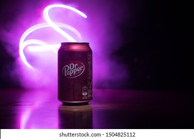 BAKU, AZERBAIJAN - SEPTEMBER 15, 2019: Can of Dr Pepper soft drink on dark toned foggy background with light. Dr Pepper was created in the 1880s.