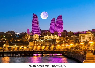 Baku, Azerbaijan - September 22, 2017: Night view of the Flame Towers. The moon above the Flame Towers. The Republic of Azerbaijan