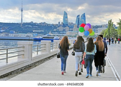 BAKU, AZERBAIJAN - SEPTEMBER 25: Undefined people go by the waterfront of Baku on September 25, 2016.