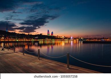Baku city boulevard and Caspian sea in evening lights after sunset