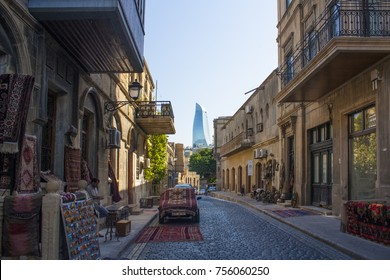 Baku - June 6, 2017. The ancient street of Old Town (Icheri Sheher) with view of Flame Towers in Baku, Azerbaijan