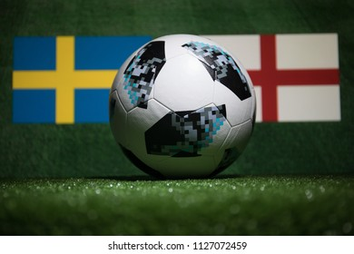 BAKU,AZERBAIJAN - JULY 04, 2018 : Creative concept. Official Russia 2018 World Cup football ball The Adidas Telstar 18 on green grass. Support your country or cheer concept. Selective focus