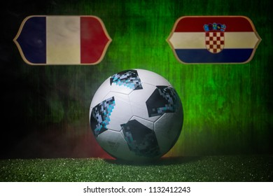 BAKU,AZERBAIJAN - JULY 12, 2018 : Creative concept. Official Russia 2018 World Cup football ball The Adidas Telstar 18 on green grass. France and Croatia. Selective focus