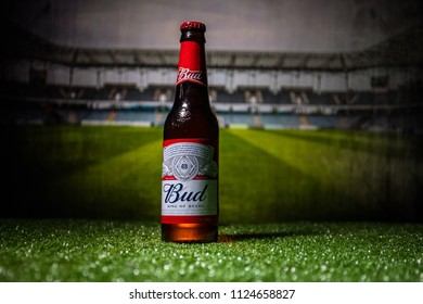 BAKU,AZERBAIJAN - JUNE 30, 2018 : Creative concept. Budweiser (Bud) Beer in bottle on grass. Support your country in World cup 2018. Selective focus