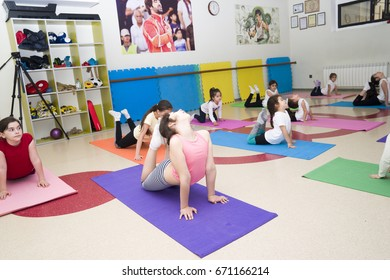 Baku,Azerbayjan-16 may 2017: Girls doing gymnastic or exercise at the fitness class with a trainer