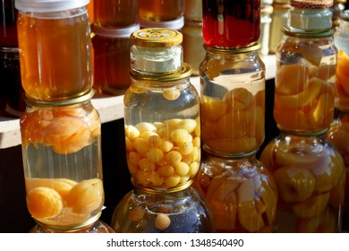 Bakuriani, Georgia, 14 January 2019: Close-up: glass jars with homemade apricot compote, strawberry compote, peach compote at the local street market.
