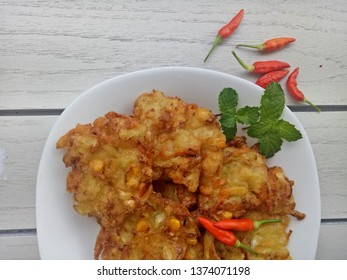 Bakwan is an Indonesian fried meal consiting vegetables and flour. As fritter snack commonly sold by gorengan (Indonesian fritter).