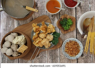 Bakwan Malang / Surabaya. East Javanese comfort food of steamed meatballs, bean curd, fried meatballs and wonton in hot beef broth with condiments of celery, spring onions, shallots, and spicy sauces.