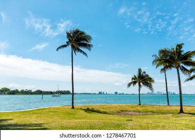 Bal Harbour Miami Florida with ocean Biscayne Bay Intracoastal water on Broad Causeway, palm trees in park and Indian Creek island