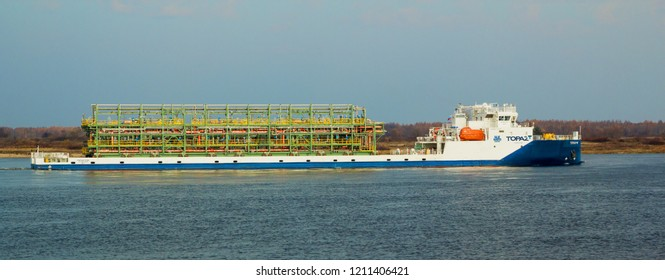 """BALAKHNA, RUSSIA - OCT 19, 2018: Cargo ship """"Topaz"""", built in Romania, sails on the Volga river near the town of Balakhna in Russia"""