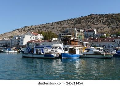 BALAKLAVA, SEVASTOPOL, REPUBLIC OF CRIMEA, RUSSIA - SEPTEMBER 19, 2014: Yachts and boats at the pier in Balaklava Bay.