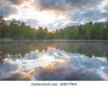 The balance between the sky and the reflection of the sky in the water in the windless weather