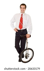 Balance in business concept - confident businessman with mono-cycle - isolated